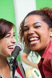 Excited Singer With Colleague Performing In Stock Photos