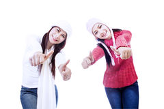 Excited sisters upon successful project-isolated Royalty Free Stock Image