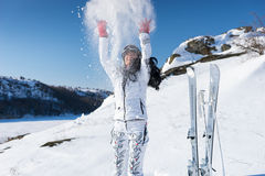 Excited skier throwing snow Royalty Free Stock Images