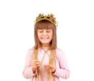 Excited small girl with golden crown and necklace Stock Photo