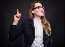 Excited smart young businesswoman pointing new idea Royalty Free Stock Photography