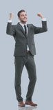 Excited smile business man raised arms, isolated over gray backg Royalty Free Stock Images