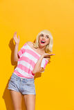 Excited smiling blonde spread her hands Stock Photo