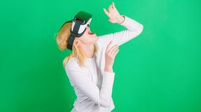 Excited smiling businesswoman wearing virtual reality glasses. Pretty woman playing game in virtual reality glasses. VR. Reality stock images