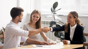 Excited smiling caucasian business people handshaking greet each other royalty free stock photo