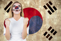 Excited south korea fan in face paint cheering Stock Image