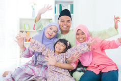 Excited Southeast Asian family. At home. Muslim family living lifestyle Stock Image
