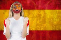 Excited spain fan in face paint cheering Stock Images