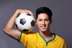 Excited sport man holding soccer Royalty Free Stock Photography