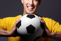 Excited sport man holding soccer Stock Photos