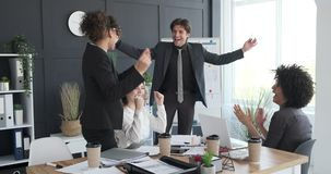 Business team celebrating success at conference room. Excited start up team celebrating business success at conference room stock footage