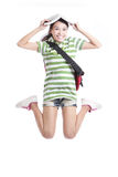 Excited student girl jumping with book. And bag in full length - isolated over white background, model are asian people Stock Photo