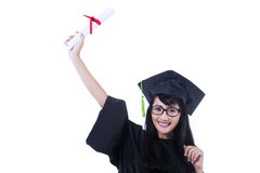 Excited student in graduation gown - isolated. Excited student wearing graduation gown on white background Stock Image
