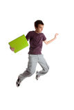 Excited student jumping. Excited male student jumping leaping high into the air.  White background Royalty Free Stock Image
