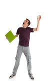 Excited student looking up. An excited amazed male teen student looking up Royalty Free Stock Photo