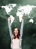 Excited student woman. Is standing with chalk board behind her Royalty Free Stock Photo