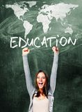 Excited student woman. Is standing with chalk board behind her Royalty Free Stock Image