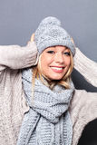 Excited stylish girl with winter hat and scarf feeling sexy Stock Image