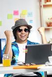 Excited Stylish Young Man Feels Satisfied Celebrating Success at. Office Royalty Free Stock Photos