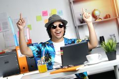 Excited Stylish Young Man Feels Satisfied Celebrating Success Po. Inting Fingers Up at Office Royalty Free Stock Photography