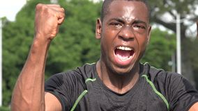 Excited Successful African Male Athlete And Victory. A handsome adult black male stock footage