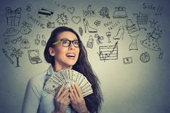 Excited successful young business woman holding money Royalty Free Stock Photography