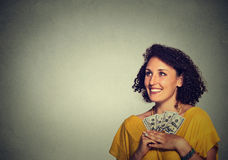 Excited successful young business woman holding money dollar bills in hand Royalty Free Stock Image
