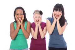 Excited surprise for ethnic teenage girl friends. Surprise and excitment for three pretty young teenager girl friends a blonde caucasian student, an oriental Stock Photos