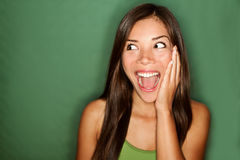 Excited / surprised. Excited - woman surprised looking to the side. Surprised happy young woman looking sideways in excitemant. Mixed race Chinese Asian / white Royalty Free Stock Photo
