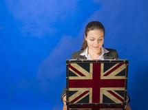 Excited and surprised businesswoman looking inside opened suitcase Royalty Free Stock Photos