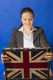 Excited and surprised businesswoman looking inside opened suitcase Stock Images