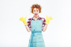 Excited surprised housewife in blue apron and yellow rubber gloves Royalty Free Stock Images