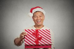 Excited surprised middle aged man opening unwrapping red gift box Stock Photos