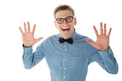 Excited and surprised young handsome male Stock Photography