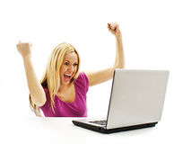 Excited and surprised young woman reading on laptop screen. Portrait of attractive surprised excited smile business woman sit at desk hold hand up looking at Royalty Free Stock Images