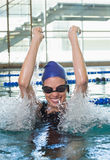 Excited swimmer cheering in the swimming pool Royalty Free Stock Photo