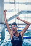 Excited swimmer jumping up the swimming pool Royalty Free Stock Photography