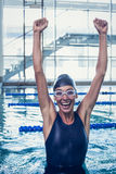 Excited swimmer jumping up the swimming pool Royalty Free Stock Images