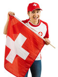 Excited Swiss sports fan. Photo of a Swiss sports fans waving a flag and cheering for her team isolated over white background Stock Image