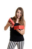 Excited teen girl with christmas present Stock Images