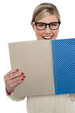 Excited teen girl holding note book close to her Stock Photo