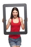 Excited teen girl looking through frame, Stock Photography