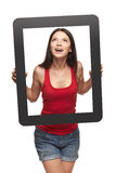 Excited teen girl looking through frame Stock Photo