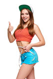 Excited teen girl measuring her waist Stock Photos