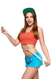 Excited teen girl measuring her waist Royalty Free Stock Photography