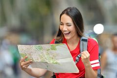 Excited teen tourist finding destination stock photo