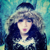 Excited teenage girl blowing snow Stock Images