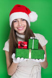 Excited teenage girl holding Christmas presents Royalty Free Stock Images