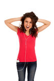 Excited teenage girl listen music Stock Photography