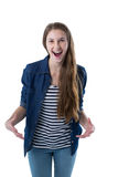 Excited teenage girl standing against white background royalty free stock photography